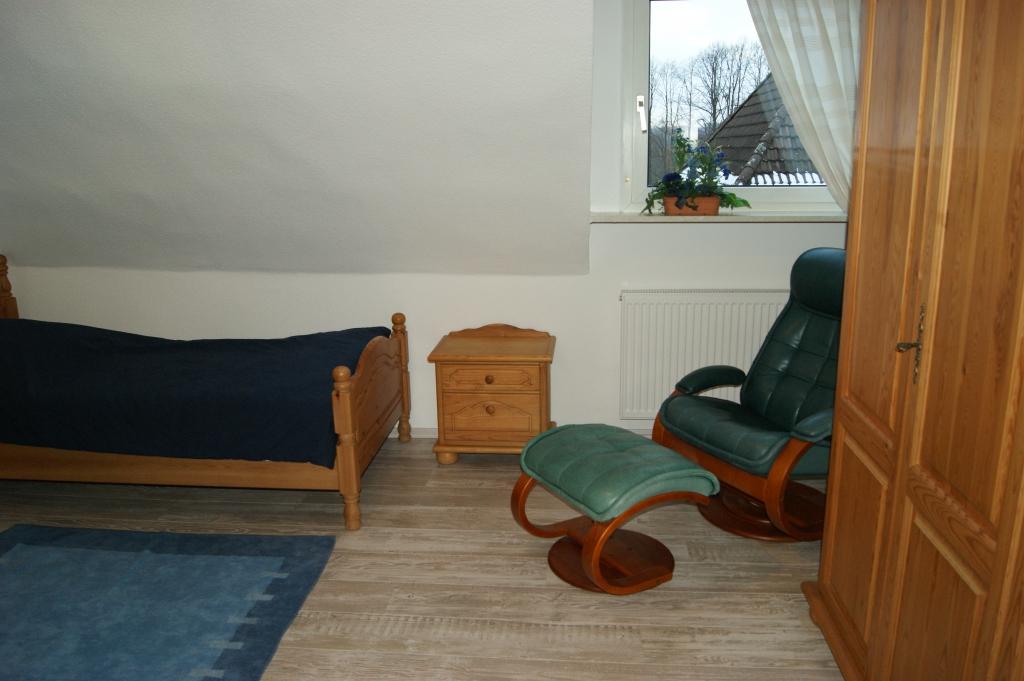 Ferienwohnungen Sidun - Hattingen / Sessel zum Ausruhen im Schlafzimmer